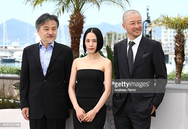 Director Kiyoshi Kurosawa actress Eri Fukatsu and actor Tadanobu Asano attend a photocall for 'Kishibe No Tabi' during the 68th annual Cannes Film...