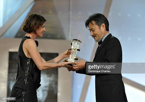Director Kiyoshi Kurosawa awarded by French Actress Irene Jacob during the 10th Marrakech Film Festival on December 9 2010 in Marrakech Morocco