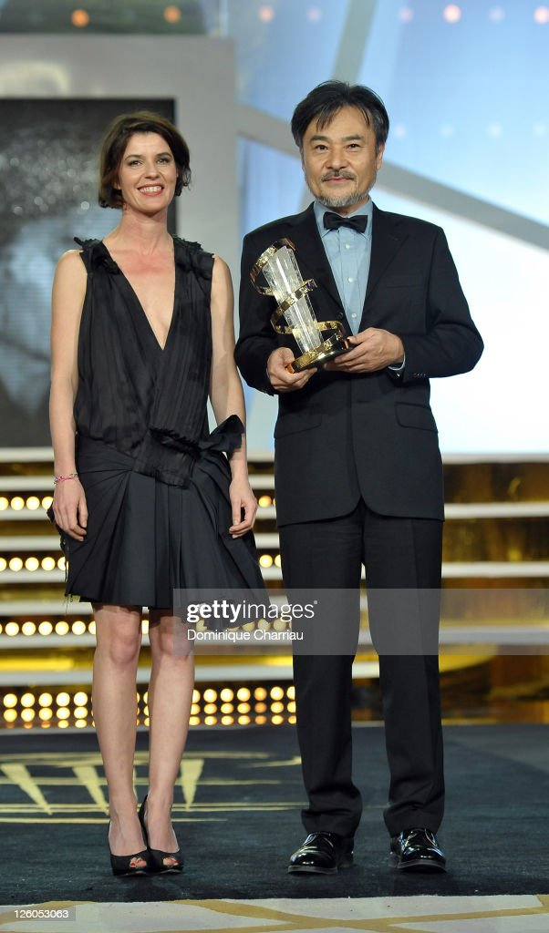 Director <a gi-track='captionPersonalityLinkClicked' href=/galleries/search?phrase=Kiyoshi+Kurosawa&family=editorial&specificpeople=3272796 ng-click='$event.stopPropagation()'>Kiyoshi Kurosawa</a> (R) awarded by French Actress <a gi-track='captionPersonalityLinkClicked' href=/galleries/search?phrase=Irene+Jacob&family=editorial&specificpeople=1534457 ng-click='$event.stopPropagation()'>Irene Jacob</a> during the 10th Marrakech Film Festival on December 9, 2010 in Marrakech, Morocco.