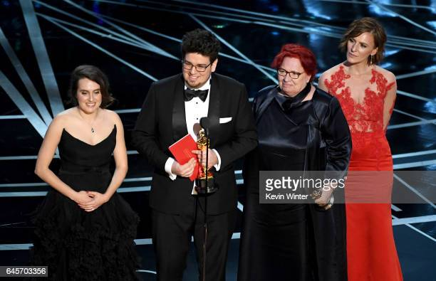 Director Kristof Deak and producer Anna Udvardy accept Best Live Action Short Film for 'Sing' onstage during the 89th Annual Academy Awards at...