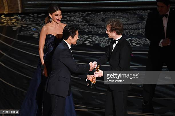 Director Laszlo Nemes accepts the Best Foreign Language Film award for 'Son of Saul' from actors Sofia Vergara and Byunghun Lee speak onstage during...