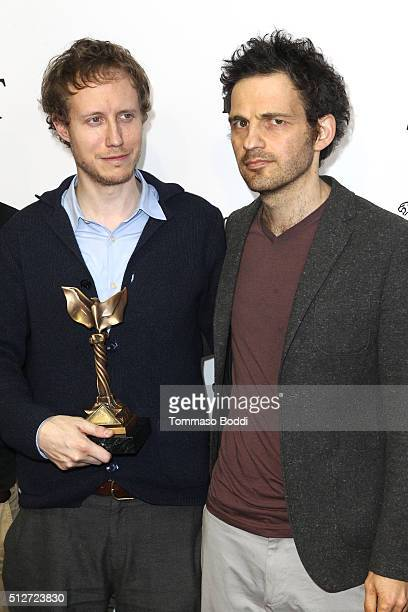 Director Laszlo Nemes winner of the Best International Film award for 'Son of Saul' and Actor Geza Rhrig pose in the press room during the 2016 Film...