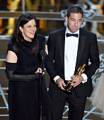 Director Laura Poitras and journalist Glenn Greenwald accept Best Documentary Feature Award for 'Citizenfour' onstage during the 87th Annual Academy...