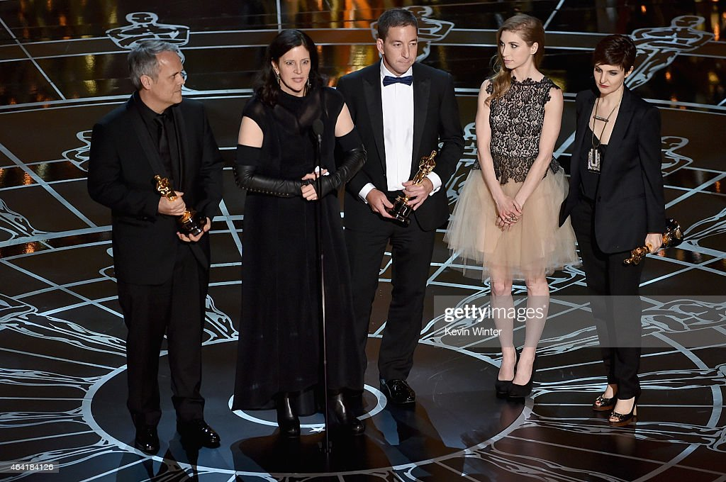 Director Laura Poitras, Dirk Wilutzky, Lindsay Mills and journalist Glenn Greenwald accept Best Documentary Feature Award for 'Citizenfour' onstage during the 87th Annual Academy Awards at Dolby Theatre on February 22, 2015 in Hollywood, California.
