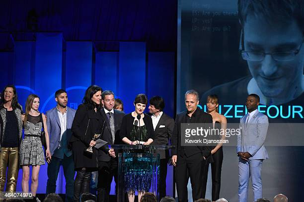 Director Laura Poitras journalist Glenn Greenwald producer Mathilde Bonnefoy and crew accept Best Documentary for 'Citizenfour' from actors Carmen...
