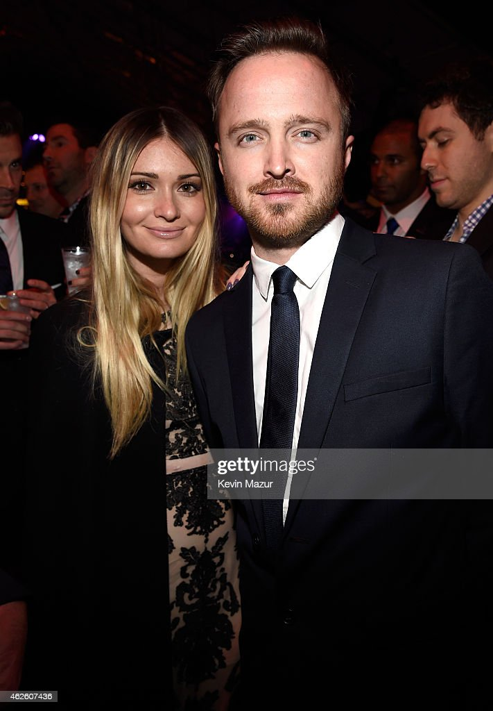 Director Lauren Parsekian and actor Aaron Paul attend DirecTV Super Saturday Night hosted by Mark Cuban's AXS TV and Pro Football Hall of Famer...