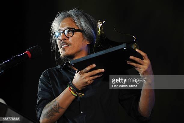 Director Lav Diaz receives Pardo doro of International Competition during 67th Locarno Film Festival August 16 2014 in Locarno Switzerland