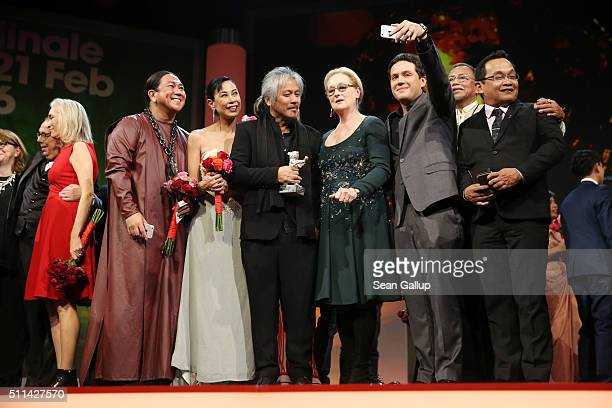 Director Lav Diaz winner of the Silver Bear Alfred Bauer trophy for his movie 'A Lullaby to the Sorrowful Mystery' poses with his cast and jury...