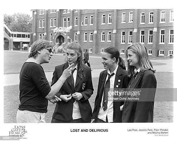 Director Lea Pool talks to actresses Jessica Pare Piper Perabo and Mischa Barton on set of the movie 'Lost and Delirious' circa 2001