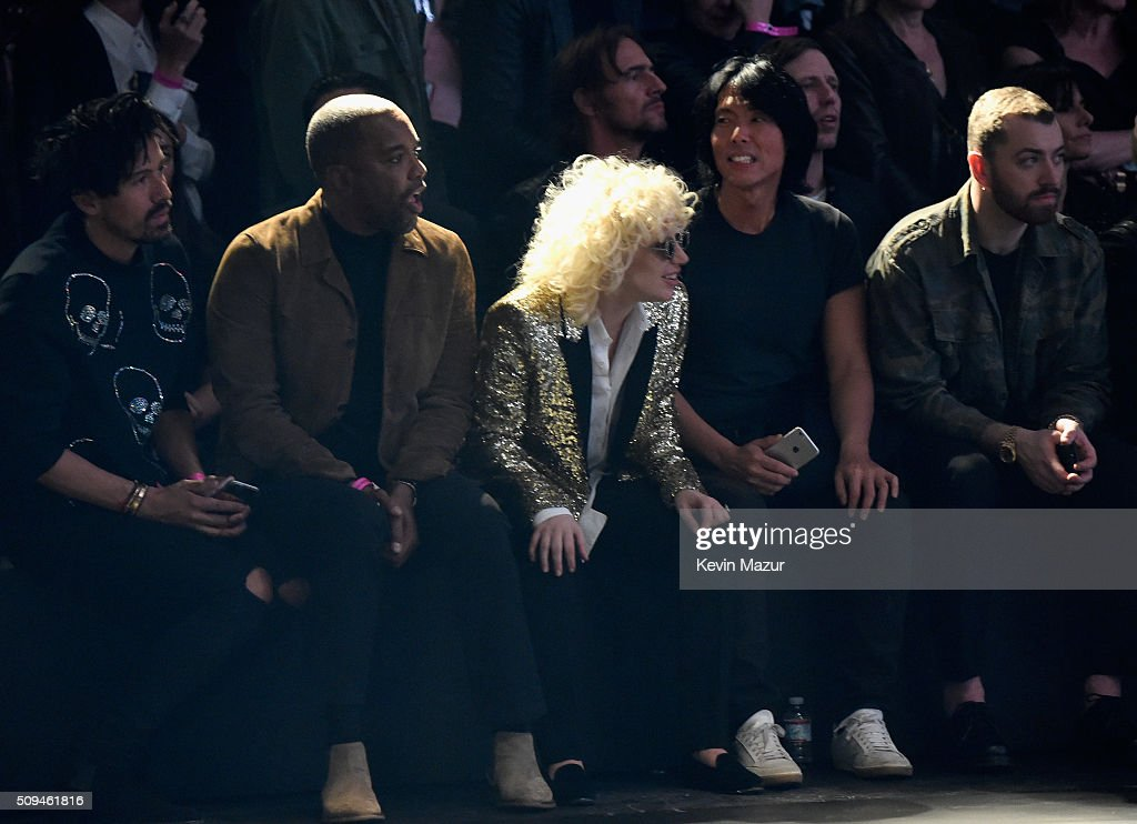 Director Lee Daniels and recording artists Lady Gaga, in Saint Laurent by Hedi Slimane, and Sam Smith attend Saint Laurent at the Palladium on February 10, 2016 in Los Angeles, California for the Saint Laurent Los Angeles show.