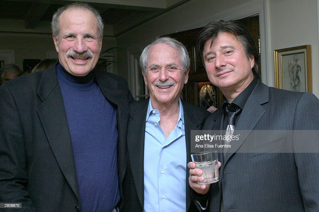 Director Lee Phillips, composer Barry DeVorzon and musician Steve Perry attend the Charlize Theron tribute reception during the 2004 Santa Barbara International Film Festival February 3, 2004 in Santa Barbara, California.