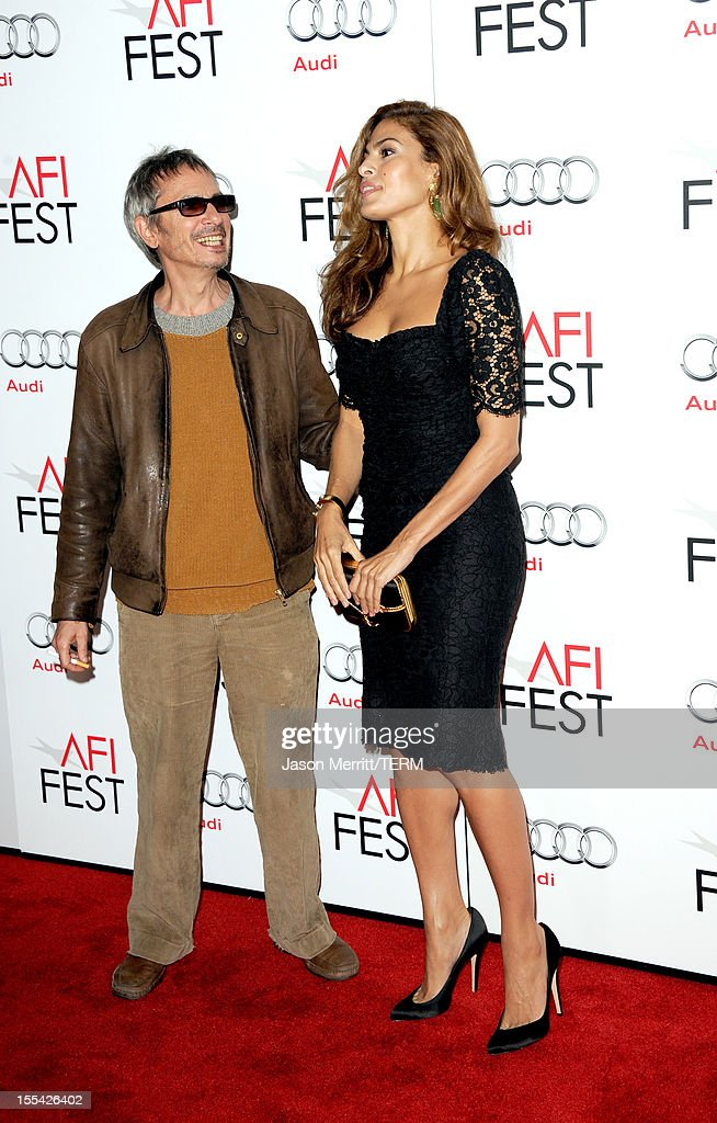 Director Leos Carax (L) and actress Eva Mendes arrive at the 'Holy Motors' special screening during the 2012 AFI Fest at Grauman's Chinese Theatre on November 3, 2012 in Hollywood, California.