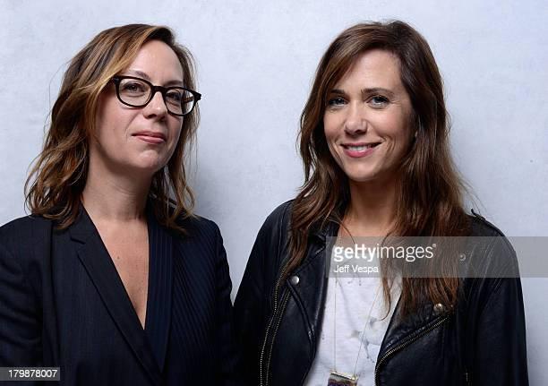 Director Liza Johnson and actress Kristen Wiig of 'Hateship Loveship' pose at the Guess Portrait Studio during 2013 Toronto International Film...