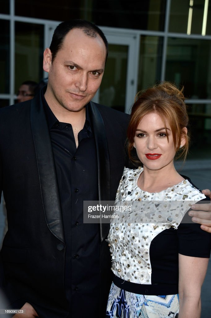 Director <a gi-track='captionPersonalityLinkClicked' href=/galleries/search?phrase=Louis+Leterrier&family=editorial&specificpeople=2455669 ng-click='$event.stopPropagation()'>Louis Leterrier</a> and actress <a gi-track='captionPersonalityLinkClicked' href=/galleries/search?phrase=Isla+Fisher&family=editorial&specificpeople=220257 ng-click='$event.stopPropagation()'>Isla Fisher</a> arrives at the Screening Of Summit Entertainment's 'Now You See Me' at ArcLight Hollywood on May 23, 2013 in Hollywood, California.