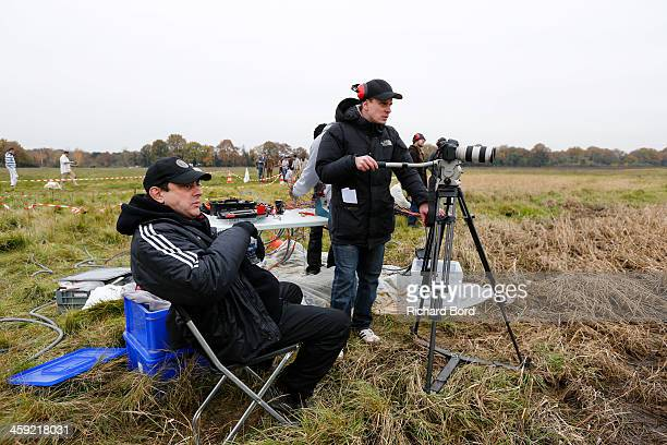 Director LouisMarc Marty check the action close to the main camera during 'Les Rabatteurs' short movie filming on December 21 2013 in Cerny France