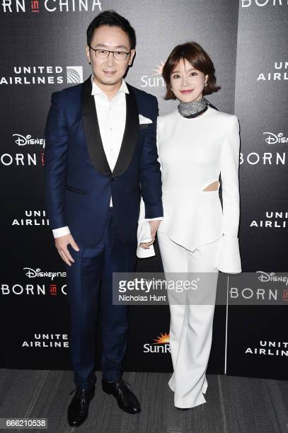 Director Lu Chuan and Hu Die attends the Disneynature With The Cinema Society Host The Premiere Of 'Born In China' at Landmark Sunshine Cinema on...