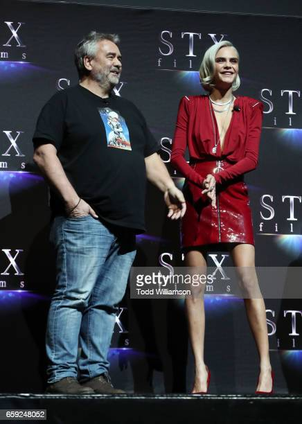 Director Luc Besson and actor Cara Delevingne speak onstage at CinemaCon 2017 The State of the Industry Past Present and Future and STXfilms...