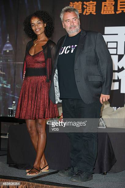 Director Luc Besson and his wife/producer Virginie Silla attend film 'Lucy' press conference at Regent Taipei on August 19 2014 in Taipei Taiwan