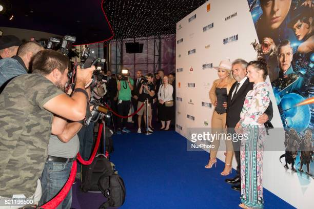 Director Luc Besson with actresses Patricia Kazadi and Olga Boladz during the 'Valerian and the City of a Thousand Planets' movie premiere at...
