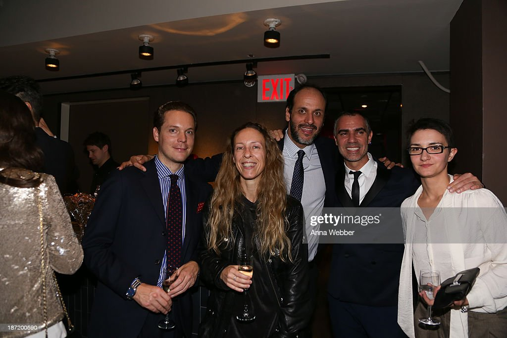 Director Luca Guadagnino (C) (wearing Ferragamo Fall/Winter Collection) and guests attend Ferragamo And Stefano Tonchi Present A VIP Screening Of Premier Film Walking Stories on November 6, 2013 in New York City.