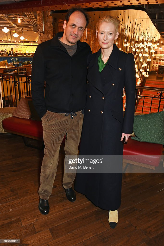 Director Luca Guadagnino (L) and Tilda Swinton attend a photocall for 'A Bigger Splash' at Picturehouse Central on February 7, 2016 in London, England.