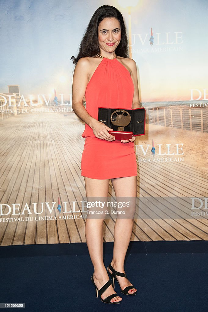 Director Lucy Mulloy poses with her trophy after the closing ceremony of the 38th Deauville American Film Festival on September 8, 2012 in Deauville, France.