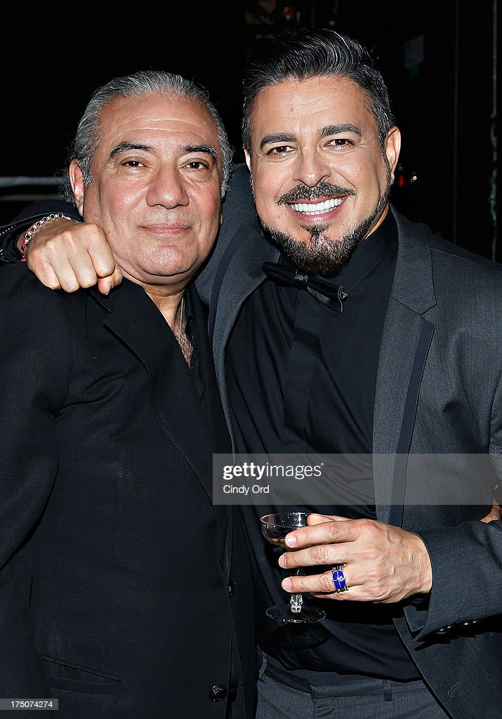 Director Luis Bravo and singer Luis Enrique pose backstage following a performance of 'Forever Tango' at the Walter Kerr Theatre on July 30, 2013 in New York City.