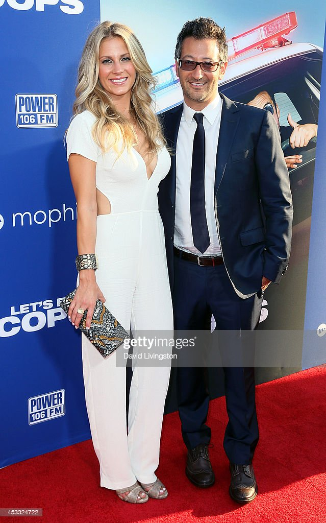 Director Luke Greenfield (R) and wife Sarah Greenfield attend the premiere of Twentieth Century Fox's 'Let's Be Cops' at ArcLight Hollywood on August 7, 2014 in Hollywood, California.
