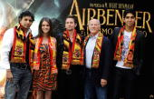 Director M Night Shyamalan actress Nicola Peltz actor Jackson Rathbone producer Frank Marshall and actor Dev Patel wear Spain national football team...