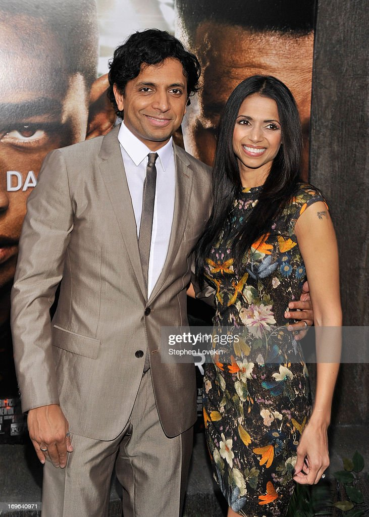 Director M. Night Shyamalan and Bhavna Vaswani attend the 'After Earth' premiere at the Ziegfeld Theater on May 29, 2013 in New York City.