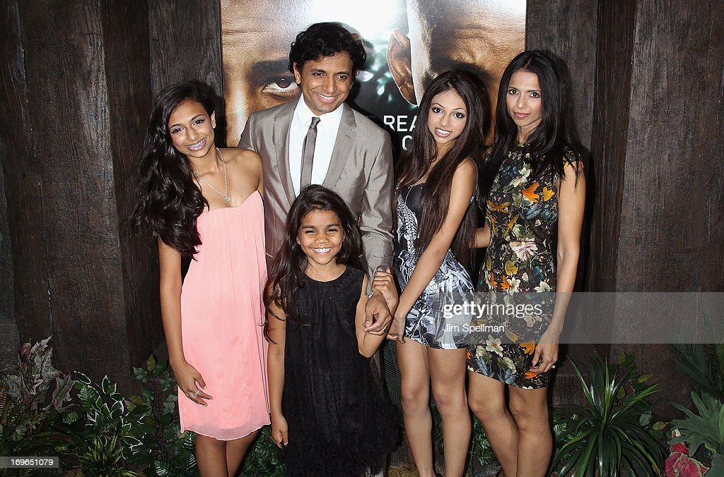 Director M. Night Shyamalan (C) and family attend the 'After Earth' premiere at the Ziegfeld Theater on May 29, 2013 in New York City.