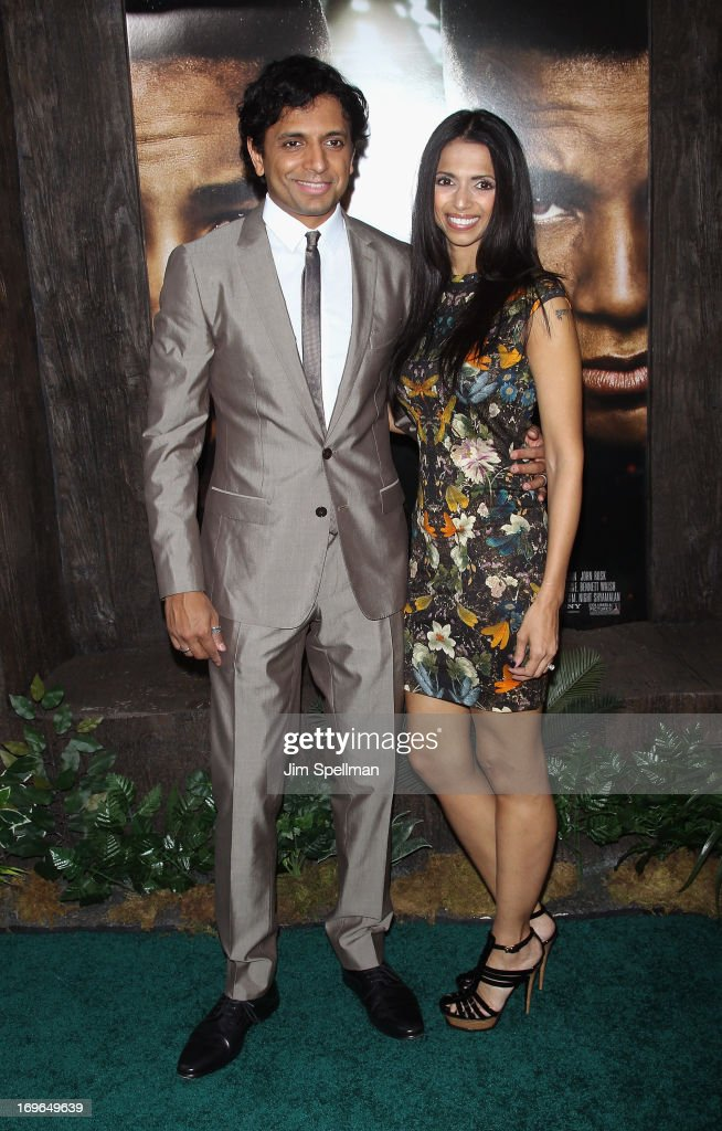 Director M. Night Shyamalan and wife Bhavna Vaswani attend the 'After Earth' premiere at the Ziegfeld Theater on May 29, 2013 in New York City.