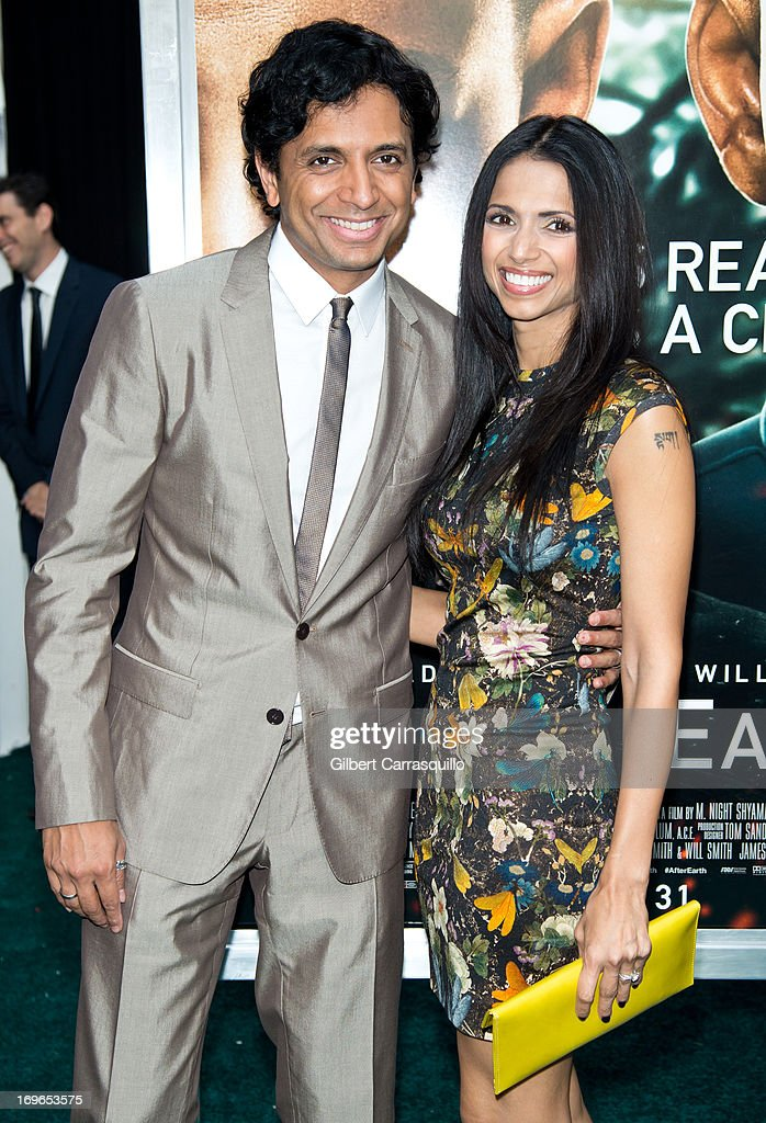 Director M. Night Shyamalan and wife Bhavna Vaswani attend the 'After Earth' premiere at Ziegfeld Theater on May 29, 2013 in New York City.