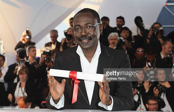 Director MahamatSaleh Haroun poses with his Jury Prize for the film 'A Screaming Man' during the Palme d'Or Award Ceremony photocall held at the...