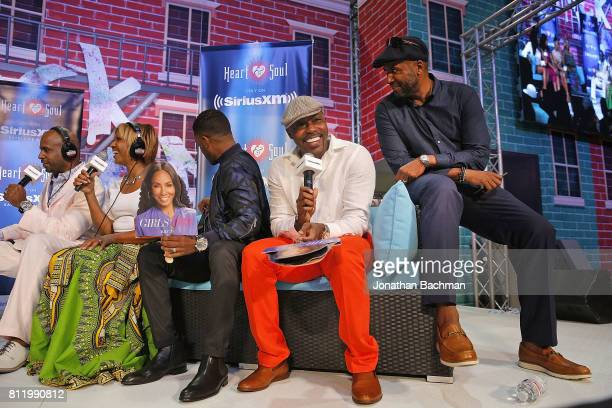Director Malcolm lee right producer Will Packer second from right and cast member Larenz Tate of the movie Girls Trip are interviewed by Cayman Kelly...