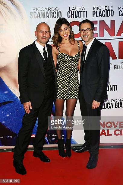 Director Marco Ponti Belen Rodriguez and Luca Bianchini walk a red carpet for 'La Cena Di Natale' at Cinema Adrinano on November 22 2016 in Rome Italy