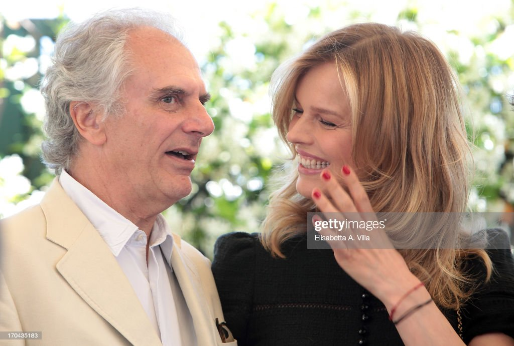 Director Marco Risi and actress <a gi-track='captionPersonalityLinkClicked' href=/galleries/search?phrase=Eva+Herzigova&family=editorial&specificpeople=156428 ng-click='$event.stopPropagation()'>Eva Herzigova</a> attend 'Cha Cha Cha' photocall at Hotel Bernini Bristol on June 13, 2013 in Rome, Italy.