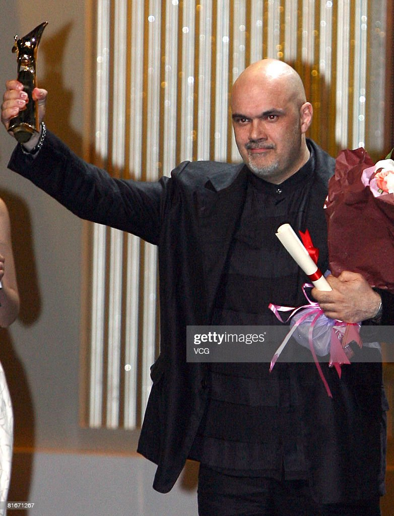Director Maris Martinsons holds an award during the Jin Jue Award Awarding Ceremony and 11th Shanghai International Film Festival Closing Ceremony at the Shanghai Grand Theatre on June 22, 2008 in Shanghai, China.