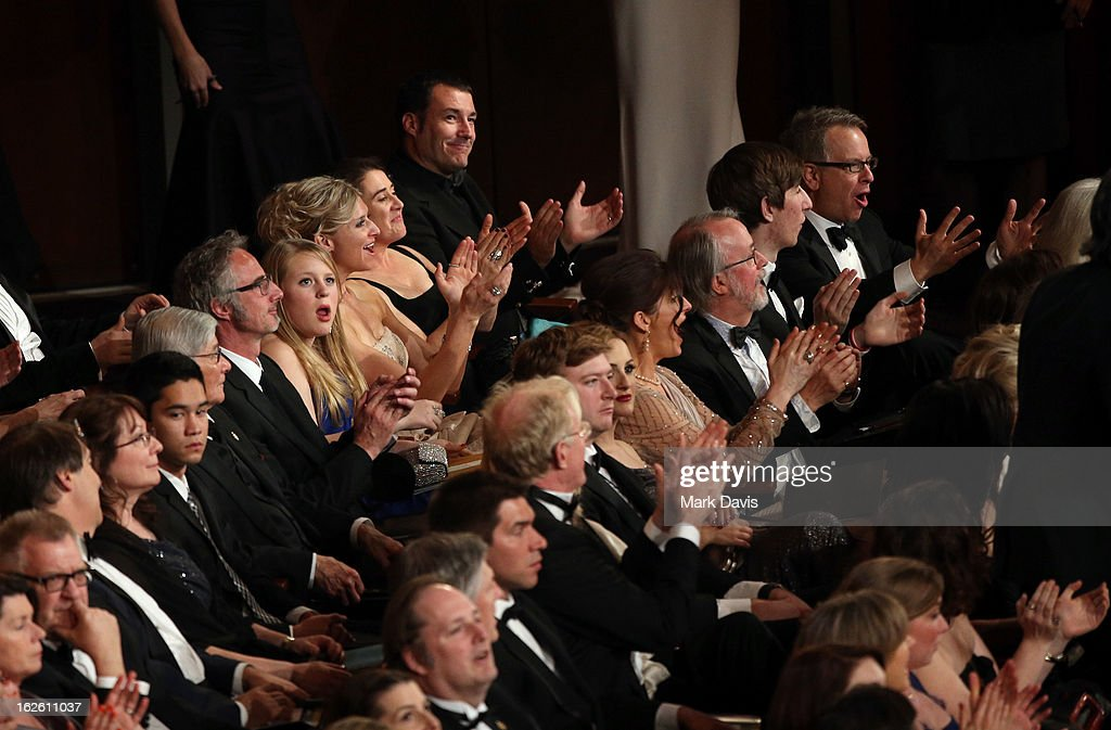 Director Mark Andrews (L Rear) applauds during the Oscars held at the Dolby Theatre on February 24, 2013 in Hollywood, California.