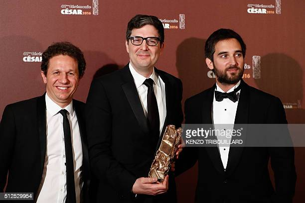 US director Mark Osborne poses with French producers Aton Soumache and Dimitri Rassam after they the Best Animated Feature award for 'Le Petit Prince...