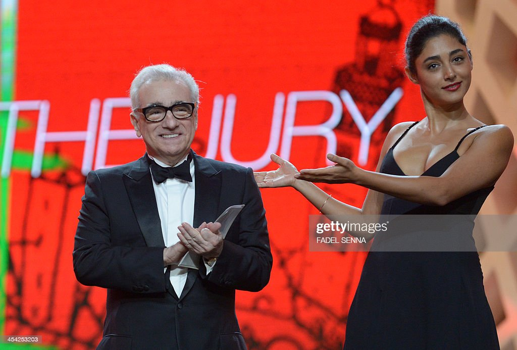 Director Martin Scorsese (L) and Iranian actress Golshifteh Farahani stand on stage during the closing ceremony of the 13th Marrakech International Film Festival on December 7, 2013 in Marrakech.