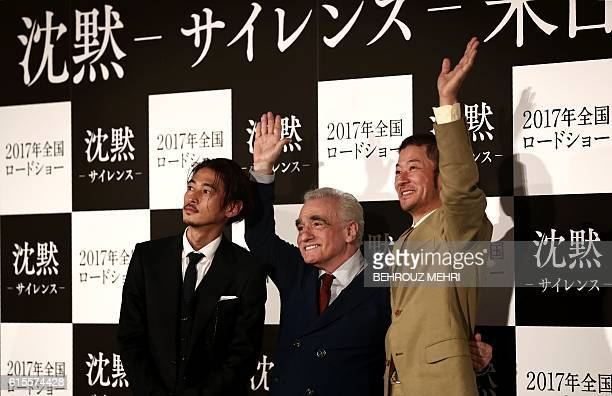 US director Martin Scorsese and Japanese actors Yosuke Kubozuka and Tadanobu Asano wave as they pose for a picture after a press conference for his...