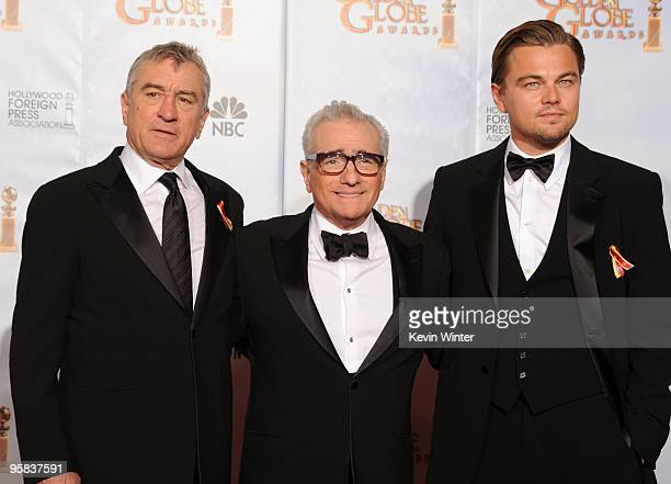 Director Martin Scorsese recipient of the Cecil B DeMille Award poses with actors Robert De Niro and Leonardo DiCaprio in the press room after...