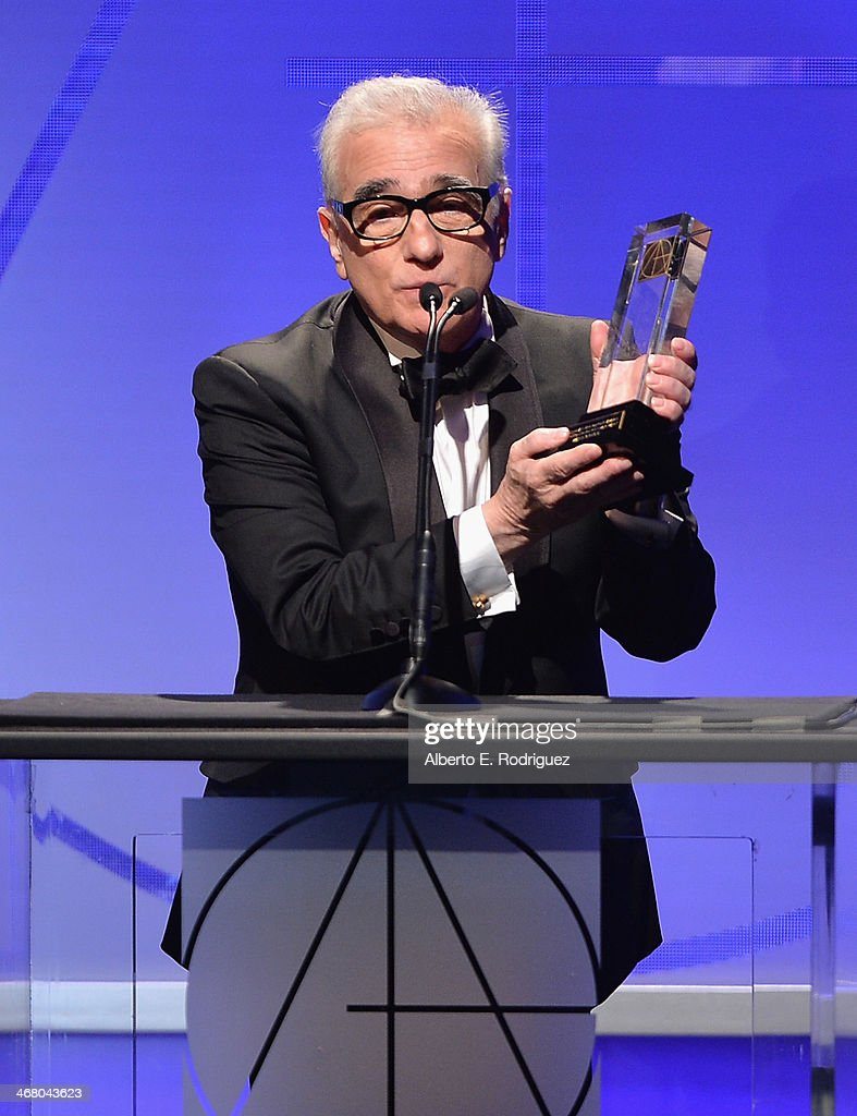 Director <a gi-track='captionPersonalityLinkClicked' href=/galleries/search?phrase=Martin+Scorsese&family=editorial&specificpeople=201976 ng-click='$event.stopPropagation()'>Martin Scorsese</a> speaks on stage atthe 18th Annual Art Directors Guild Exellence In Production Design Awards at The Beverly Hilton Hotel on February 8, 2014 in Beverly Hills, California.