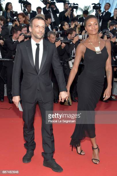 Director Mathieu Kassovitz and guest attend the 70th Anniversary of the 70th annual Cannes Film Festival at Palais des Festivals on May 23 2017 in...