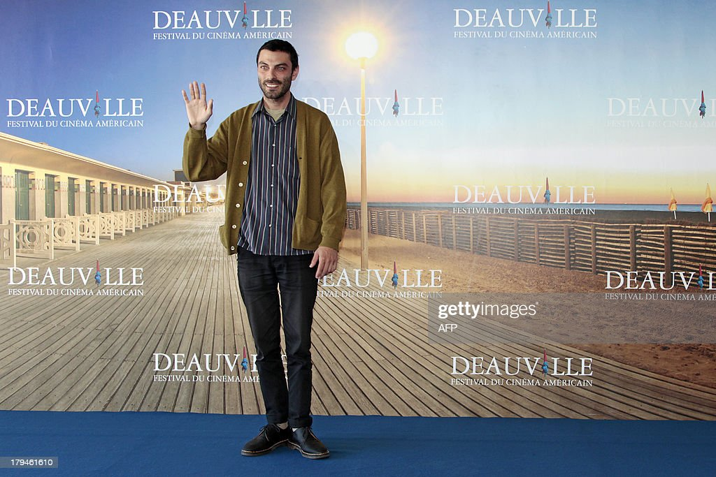 US director Matt Creed poses during a photocall to present 'Lily', his latest movie on September 4, 2013 as part of the Deauville US Film Festival, in the French northwestern sea resort of Deauville.