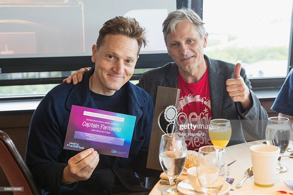 Director Matt Ross (L) and actor Viggo Mortensen pose for a photo after winning the Seattle International Film Festival Golden Space Needle Award for best film 'Captain Fantastic' at the Space Needle on June 12, 2016 in Seattle, Washington.