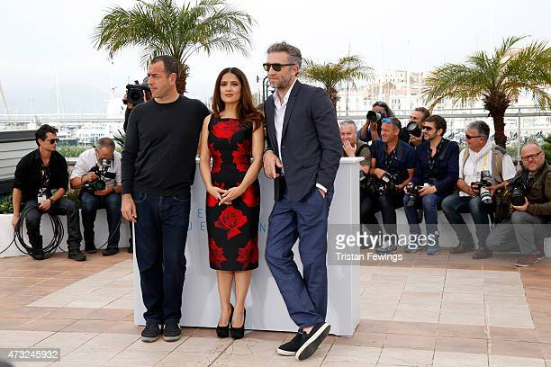 Director Matteo Garrone actress Salma Hayek and actor Vincent Cassel attend a photocall for 'Il Racconto Dei Racconti' during the 68th annual Cannes...