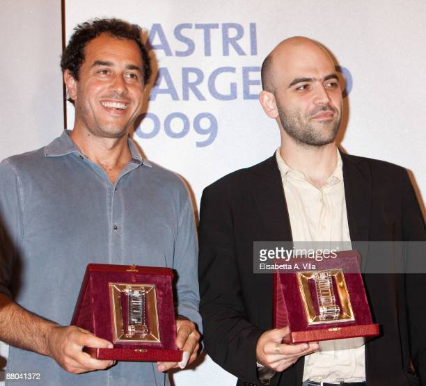 Director Matteo Garrone and writer Roberto Saviano receive the awards for the movie 'Gomorra' during the 2009 Nastri D'Argento Nominations Dinner...
