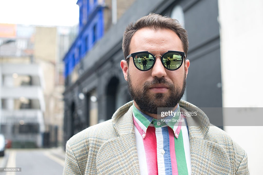 TV director Maurizio Von Trapp wears a Vivienne Westwood coat, Ralph Lauren shirt andTopman sunglasses on day 2 of London Collections: Men on June 16, 2014 in London, England.